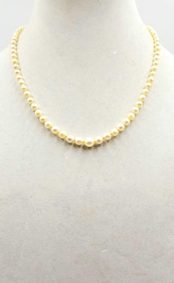 Understated Elegance. 14K yellow gold, graduated cultured pearl necklace on buttercup silk.