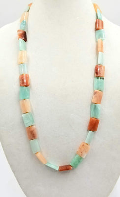 Alternating peach & aqua aventurine rope on golden silk. 32