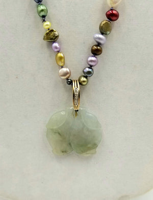 14K Yellow Gold, multi-color pearl necklace with diamond jadeite pendant on lavender silk.