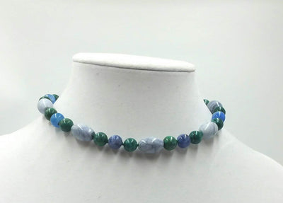 Sterling silver, azurite, marble,and malachite necklace on verde silk. 13
