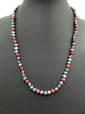 14KYG, matinee length, black & red pearl necklace on white silk. 24