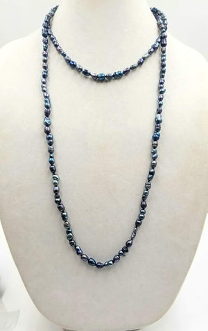 Past Work. Rope of black and blackish blue pearls.