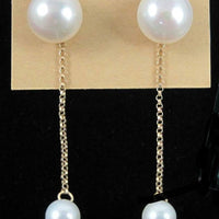 Past Work. 14KYG white pearl dangle stud earrings.