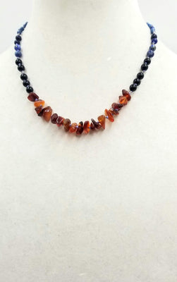 Past Work. Sterling silver, lapis lazuli, onyx, & carnelian necklace on blue silk. 18