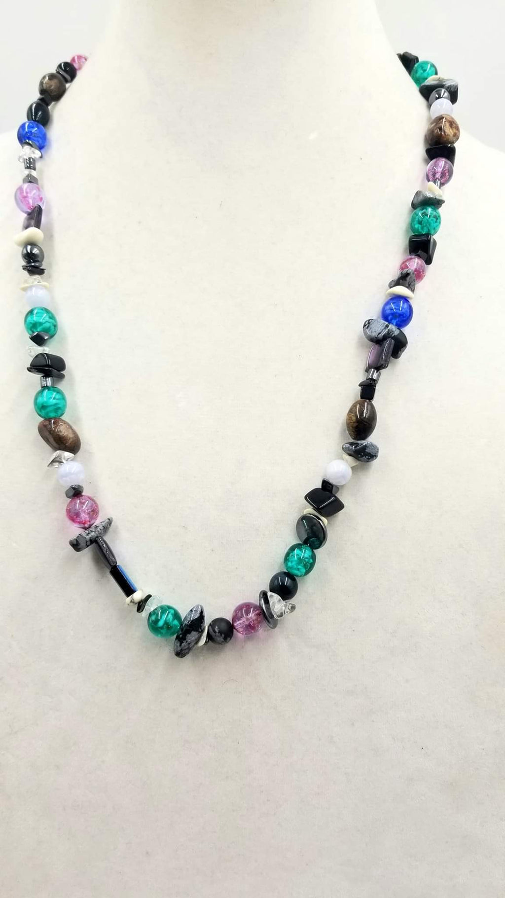 "Past Work. Sterling silver, onyx, abalone, chalcedony, howlite, hematite, art glass necklace. 26"" Length. Sold."