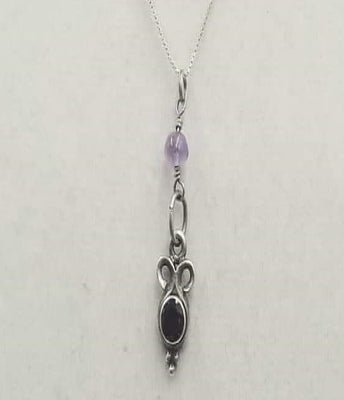 Sterling silver, garnet & amethyst pendant on chain. 18