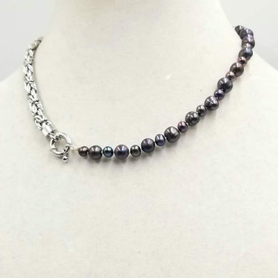 Stunning unisex necklace. Sterling silver & black pearl necklace on white silk. 17.5
