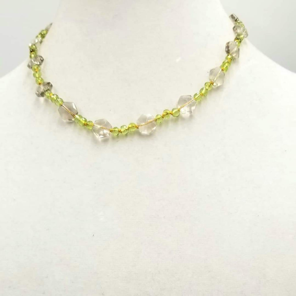 "Faceted peridot & smoky quartz sterling silver necklace on golden silk. 17"" Length."