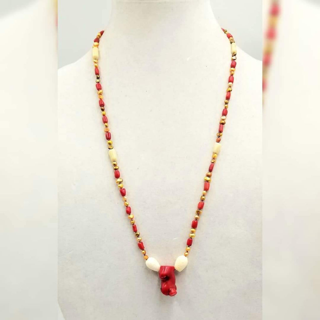 "Bi-tone coral,  golden fresh-water cultured pearls, on lavender silk with sterling silver clasp. 28"" Length."