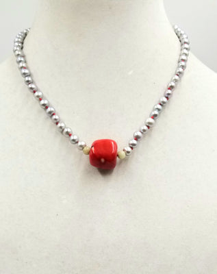 Silvery pearls on crimson silk, with coral and nephrite jade focal & sterling silver clasp. 18.25
