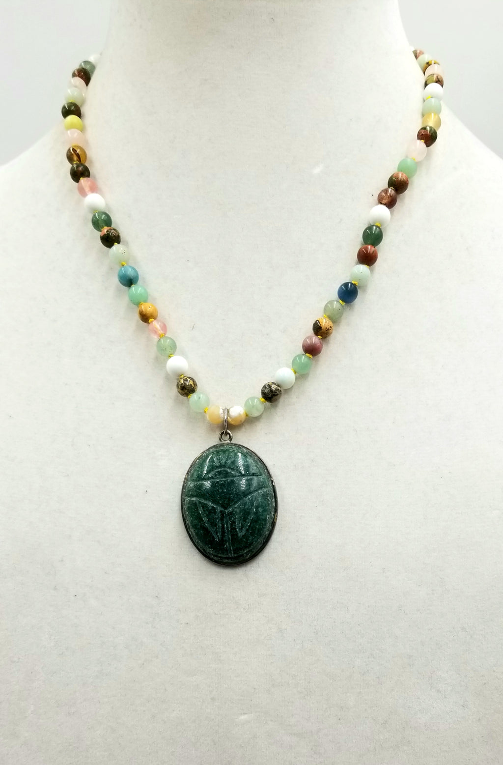 "Sterling silver, multi-stone, multi-color aventurine Scarab necklace on canary yellow silk. 19.25"" Length."
