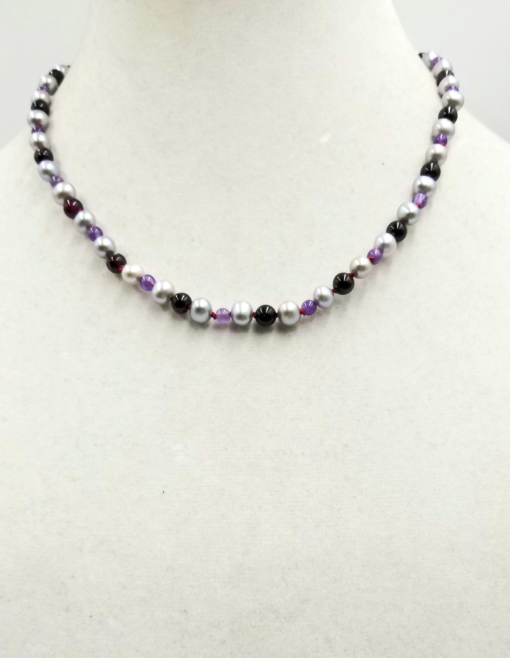 "Sterling silvery pearl, garnet, & amethyst necklace on crimson silk. 18.25"" Length."