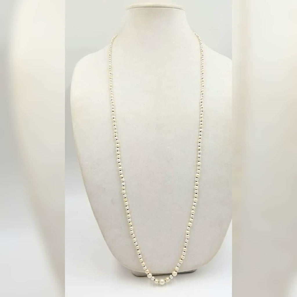 Rope of cultured freshwater pearls on rose silk.