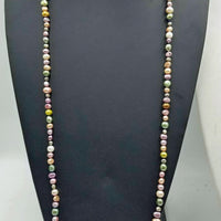 Very Long, multi-color rope, pearls, individually knotted on silk. Could be used as a head band also.