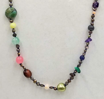 Bronze pearls, agate, coral, malachite, moonstruck, tiger's eye, garnet, jasper,tourmaline, amethyst 10KYG necklace on navy silk. 32