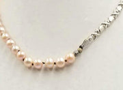 "Past Work. Adjustable, Sterling Silver & beige pearl necklace on chocolate silk. 16.5"" - 19.25"""