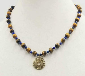 "Men & women, take a look at this Tiger's Eye & Lapis Lazuli, Sterling Silver vermeil pendant necklace on white silk. 19"" Length."