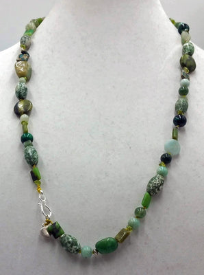 Beautiful long necklace made of sterling silver & various green stones.