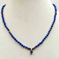 For auction at O'Gallerie in Sept. Stunning! Made for a Queen. Lapis Lazuli & Cranberry pearls on chocolate silk. 14KWG with a 10KWG amethyst & diamond pendant.