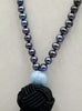 Exquisite Peacock pearl mala necklace on black silk with aquamarine guru bead.