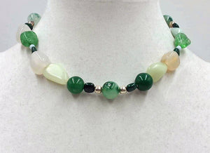 Pretty necklace of jadeite, malachite, chalcedony, nephrite & sterling silver toggle.