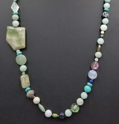 Beautiful statement piece. Turquoise colored stones & sterling silver beads are stunning.