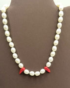 "Past Work ""Little Fang"" a darling goth necklace of Sterling silver, pearl, & red coral on hand-knotted brown silk. 17"" Length. Sold"