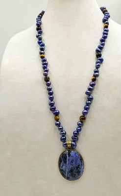 Indigo dyed freshwater cultured pearls & tiger's eye necklace with brass sodalite pendant with hand-knotted coppertone silk.