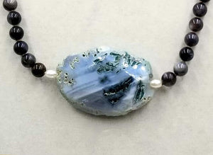 Stunningly gorgous sterling silver, Mother of Pearl & blue agate necklace on coppertone silk.  25.25""