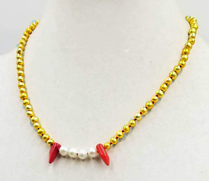 "Golden pearl, coral &  sterling silver fang necklace on crimson silk. 20"" Length."