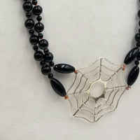 """Black Widow"" A long, two-strand, onyx & sterling silver spiderweb necklace with smoky quartz accents on hand-knotted coppertone silk. 34"" Length."