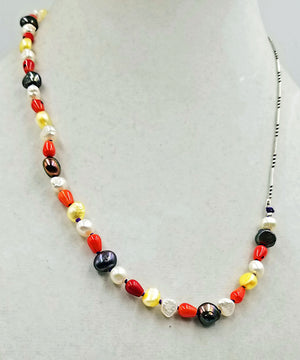 "Like Halloween Candy?  Coral, multi-colored freshwater cultured pearls, & sterling silver,  unisex necklace with hand-knotted purple silk. 21"" Length."
