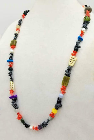 "A wild & beautiful collage of gem stones, art glass, bone & more, hand-knotted with white silk. 36"" Length."