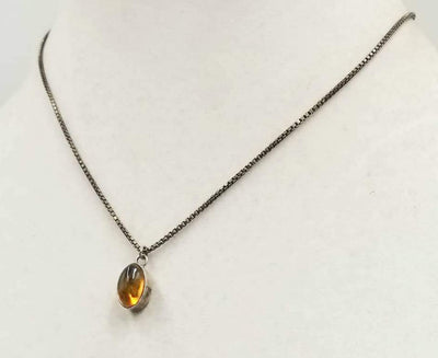 Pretty! Sterling silver chain with a Baltic amber pendant necklace. 16