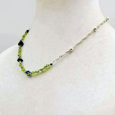 Unisex, adjustable, sterling silver, peridot & lapis lazuli necklace strung with verde silk. 20