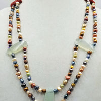 "Sterling silver, multi-color freshwater & cultured pearl with coral & prehnite, hand-knotted with purple silk. 27"" length."