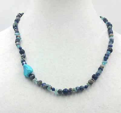 Adjustable multi-stone % sterling silver necklace.
