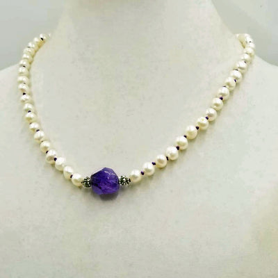 Stunning statement piece. Sterling silver, white fresh-water pearls, &  amethyst focal necklace, double hand-knotted with purple silk.