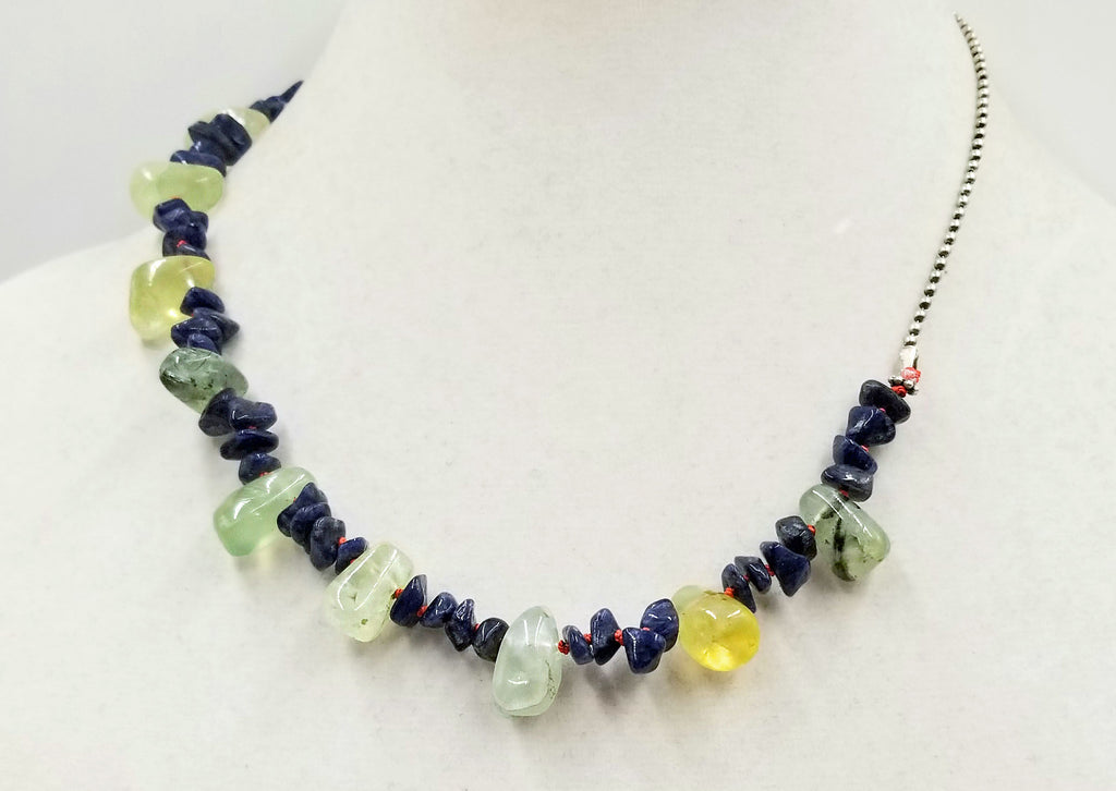 Blue aventurine & prehnite on hand-knotted bright crimson silk, with an adjustable sterling silver chain. An ideal unisex necklace that will get attention.