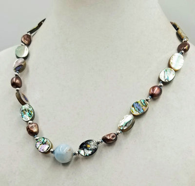 Sterling silver, abalone, bronze baroque pearls, with aquamarine focal necklace on hand-knotted sky blue silk. 21.25