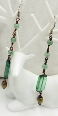 Green art glass & copper long dangle earrings. Sterling silver hooks for pierced ears.