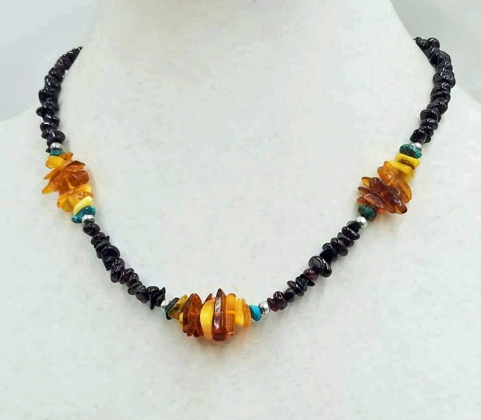 "Past Work. Really special. You will get lots of compliments. Sterling silver, garnet, Baltic amber, turquoise necklace. Vegan. 18"" length. Sold."