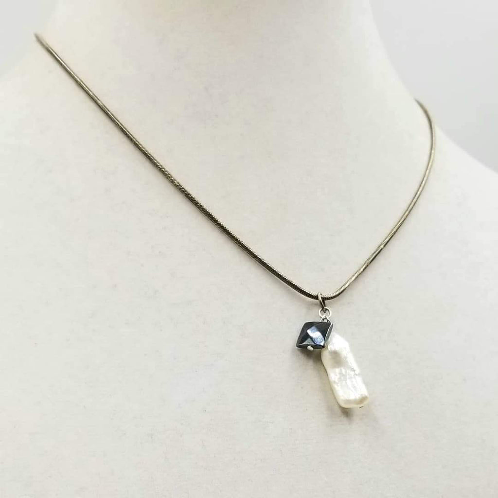 "Past Work. Sterling silver, biwa pearl & hematite pendant necklace. 18"" length. Sold."