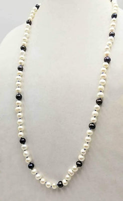 Classic & beautiful, yet modern.  Black & peacock pearl rope necklace hand-knotted with periwinkle silk. 35