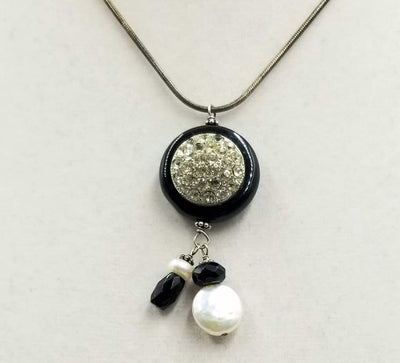 Simply beautiful. Sterling silver, onyx, & pearl pendant necklace. 16