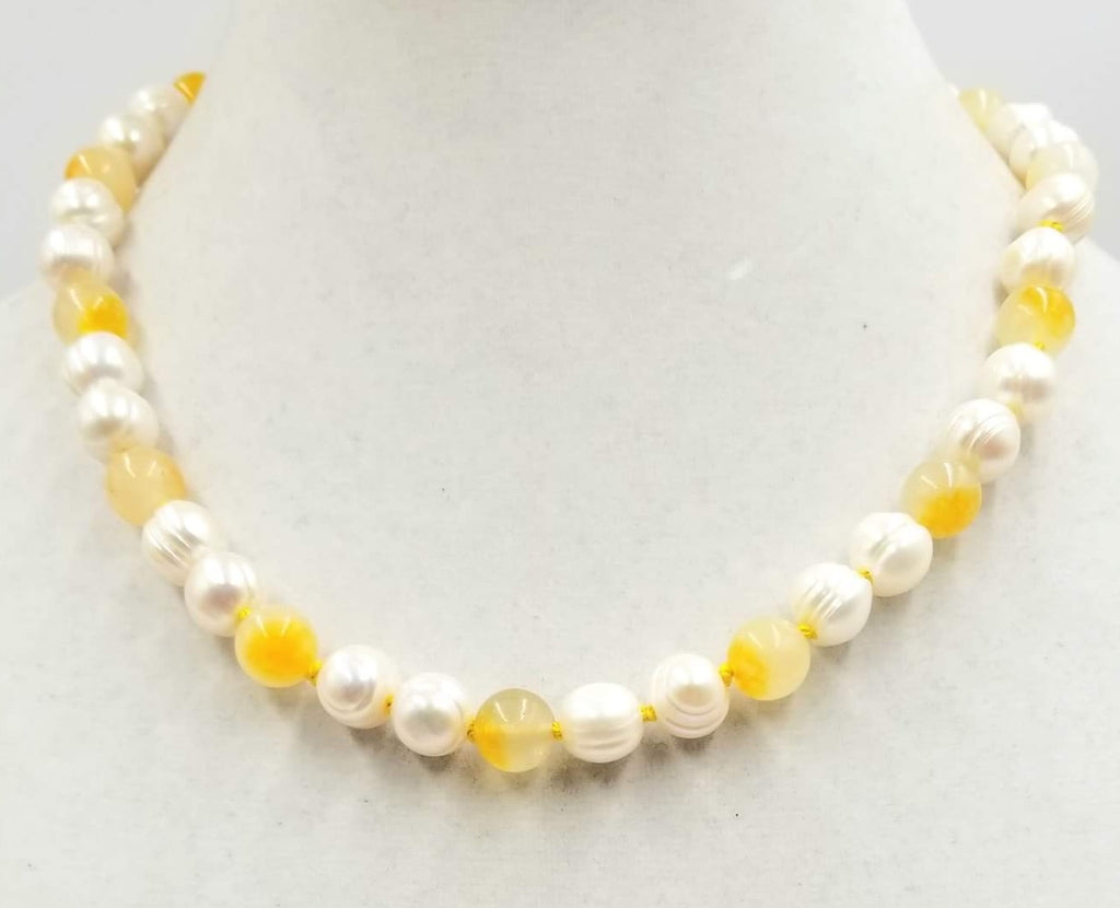 "Classy & Unusual. 14K yellow gold, pearl, & Precious Yellow Jadeite necklace. Masterly hand-knotted with golden silk. 19"" length."