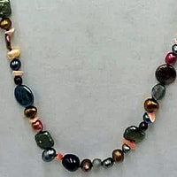 Opera length multicolor pearl, coral, labradorite, sunstone, citrine, and chrysopraise on scarlet silk with 14KYG clasp and accents.