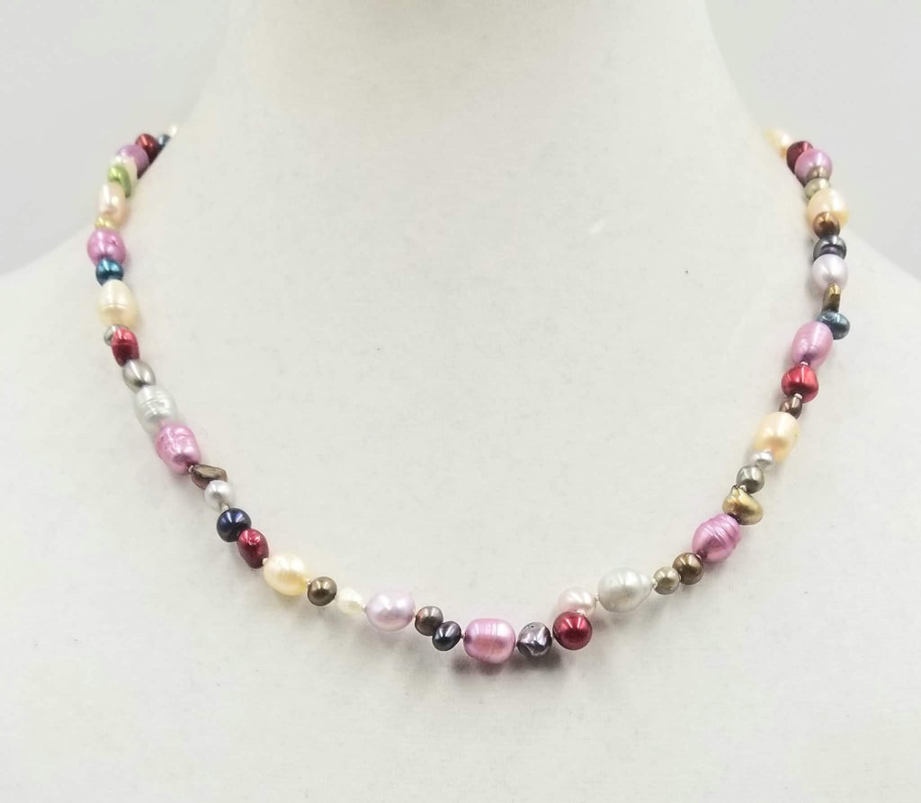"Beautiful multi-colored pearls, 14KYG, necklace on white silk. 20"" Matinee length."