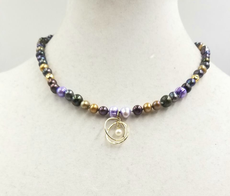 Multicolor pearl & 14KYG atomic pendant necklace on periwinkle silk.