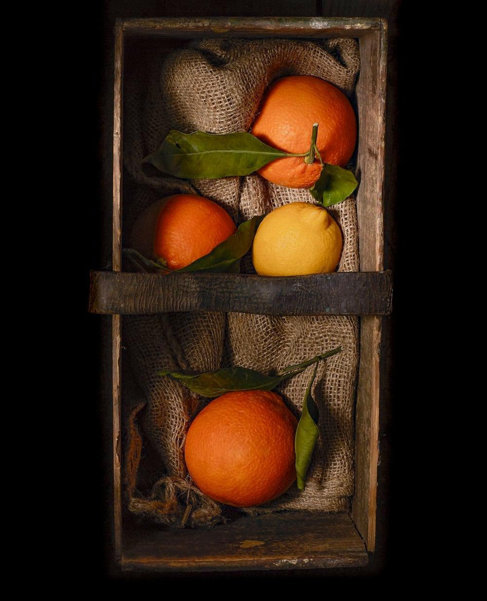 CITRUS FRUITS IN OLD WEATHERED BOX